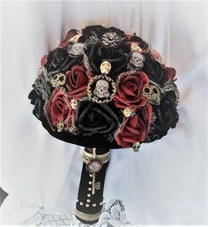 Victorian Gothic Wedding Flower Bouquet-Alternative Wedding-Skull Wedding-Day of the Dead-Renaissance Wedding-Fantasy Wedding-Game of Thrones  This large and showy Bouquet will go with many different Wedding Themes  Gothic, Victorian Steampunk, Victorian Renaissance, Victorian Gothic, Renaissance, Medieval Renaissance, Skull Weddings, Halloween..You name it..it works  Made with 30 True Touch roses in Deep Black, and Blood Red/Burgundy Hand painted roses  All around the Bouquet are Brass...