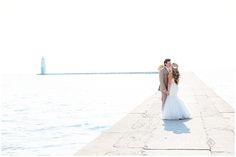 Bride and Groom on Pier in Frankfort Michigan after Lake Michigan Beach Wedding.  Elberta Life Saving Station Wedding Harbor Lights Resort | Rayan Anastor Photography | Frankfort MI Northern Michigan Wedding