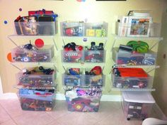 DIY PROJECT:  Wire Shelving + Plastic Boxes = Great way to keep a playroom organized and keep toys off the floor for easy cleaning