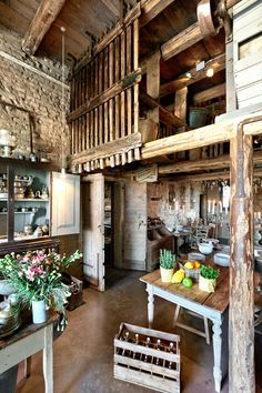 rustic Italian kitchen - I love everything about this. I love the rough edges. I love the cobbled wall. I love the open rafters and quasi-loft storage. I love the rough metal, the hewn look of the wood, and all the different shades of brown. Barn Kitchen, Country Kitchen, Kitchen Living, Kitchen Ideas, Kitchen Wood, Country Life, Wooden Kitchens, Cosy Kitchen, Space Kitchen