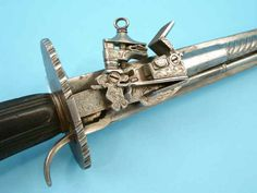 Spanish miquelet sword pistol
