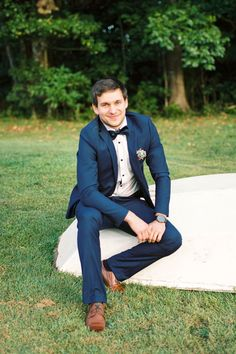 Groom wearing navy suit, silk bow tie and brown shoes   Casey Jane Photography   See more: http://theweddingplaybook.com/romantic-gold-pink-vintage-wedding/