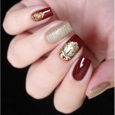 Red and Gold Nail Art by @vellinails; check it out at http://www.nailitmag.com/nail-art-of-the-day/red-and-gold-nails