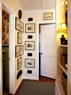 hallway decorated with pictures and trays