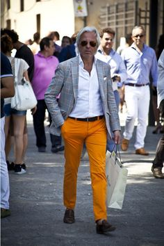 Shop this look on Lookastic: http://lookastic.com/men/looks/chinos-and-loafers-and-belt-and-pocket-square-and-dress-shirt-and-blazer/195 — Orange Chinos — Brown Leather Loafers — Brown Leather Belt — White Pocket Square — White Dress Shirt — Grey Plaid Blazer