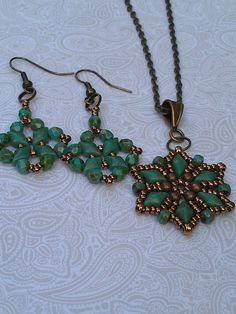 Starflower pendant and matching diamonduo earrings using ANY BEAD pattern from Deborah Roberti (around the beading table) The beads are turquoise picasso and bronze.
