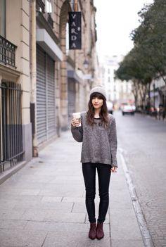 Grey sweater, beanie, and dark pants. Sweater season is coming.