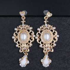 Find More Drop Earrings Information about Fashion queen gold cutout vintage pearl pendant drop earrings 2015 women baroque royal crystal beads big earrings A933,High Quality earrings buttons,China earring storage Suppliers, Cheap earring hoop from The Sunny Day on Aliexpress.com