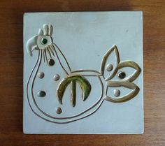 Bennington Pottery trivet or wall hanging FREE SHIPPING to the U.S. by MahoganyTown on Etsy https://www.etsy.com/listing/150068364/bennington-pottery-trivet-or-wall