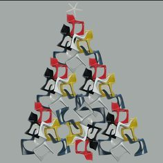 A Christmas tree made up of designer chairs. The miniature 290 Modo chairs designed by Danish designer Steen Ostergaard and a sea-star. Yes, the chairs are stackable!