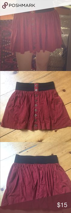 Red skirt with fake buttons going down the front Cute red skirt with fake buttons going down the front. Forever 21 Skirts Circle & Skater