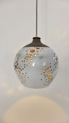 Ceramics made in Los Angeles. Lighting and wall hangings made of stoneware by ceramicist Heather Levine. Ceramic Lantern, Ceramic Light, Ceramic Pendant, Ceramic Pottery, Ceramic Art, Ceramic Lamps, Pottery Houses, Antique Lamps, Pottery Designs
