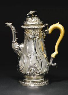 A George II silver coffee pot, Fuller White, London, 1756 embossed with spiral…