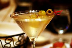 dirty martini    extra dirty, grey goose, just the way I like it.  Need one bad.....