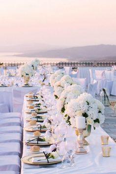 Rooftop wedding ideas have such potential to be creative and mesmerizing! Photo via Kasper Creations