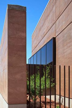 At 16,000 square feet, the commercial PERA Building in Santa Fe, NM is the largest rammed earth structure in the Southwest. Its 24″ walls were formed with Abiquiu red earth and 5% concrete, mixed dry and compacted in forms.