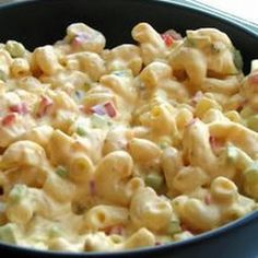 Amish Macaroni Salad - A colorful and flavorful macaroni salad made with hard cooked eggs, bell pepper and celery in a creamy dressing.