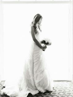 {Bride Standing In Front Of A Window}