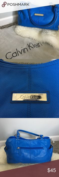 Calvin Klein purse I used this bad for one winter season and then it become another member of my purse collection that don't get used. It has been stored in the dust bag always when not in use. It will come with the dust bag also! There is very minor wear as pictured but is in such great condition! 💙All Items 8 dollars or more are negotiable 💙I do not use any other sellers app 💙Ask any questions you wish about any of my products  💙Bundles are more negotiable  💙Happy poshing Calvin Klein…