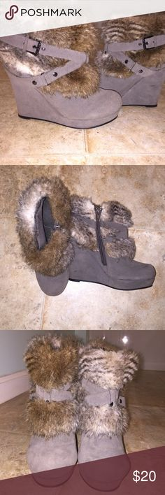 Guess Furry Wedged Booties These taupe colored booties are adorable! They have neutral colored faux fur around the top and are embellished with two buckles. They will be perfect paired with leggings and a tunic for the fall. The height of the wedge is a little over 4 inches and the platform is an inch. Let me know if you have any questions! Guess Shoes Ankle Boots & Booties