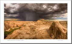 A cloudburst over Badlands National Park in South Dakota. Photography by Bruce Ellingson.