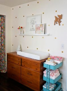 This eclectic nursery is styled to perfection! Love the @IKEAUSA cart used for diaper supplies.