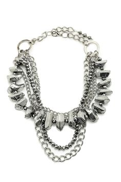 Silver metal necklace featuring 5-strands of sparkly silver titanium crystals, various sizes of textured silver metal chains, and silver Swarovski crystals. This necklace is edgy, yet elegant, and extremely fun. Can match any outfit! Dress it up or down.