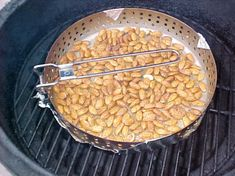 Use a pan with sides. Or you can use tin foil with the ends folded as sides. I use a vegetable pan I found in the camping section of a department store and cover the bottom with foil to prevent burning the almonds through the holes of the pan.