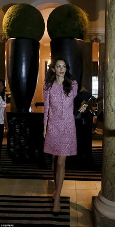Smart: The human rights lawyer was dressed in a pink tweed jacket and skirt for her meetings, held at a city hotel