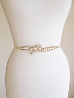 Skinny bridal belt sash, Crystal wedding belt, Pearl and crystal bridal belt, Rhinestone and pearl belt, Bridal belt in gold or silver by SabinaKWdesign on Etsy https://www.etsy.com/listing/240957978/skinny-bridal-belt-sash-crystal-wedding