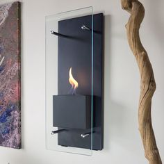 Add excitement to any setting with the Nu-Flame Cannello Wall Mounted Fireplace . Accent possibilities abound with this modern torch. Decor, Wall Mounted Fireplace, Modern, Wall, Home Decor, Ethanol Fireplace, Indoor Fireplace, Home Decor Outlet, Wall Mount