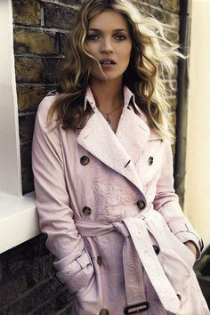 Kate Moss photographed by Mario Testino in 2005 wearing a limited edition pink Burberry trench coat. Christopher Bailey created the one-off piece to coincide with National Breast Cancer awareness month