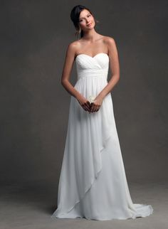 """There's no rule that says your walk-down-the-aisle dress has to have lots of going on. Simple can be """"wow"""" too, and as a bonus, you can save some money when you're not shelling out for extra trimmings. One no-fail way to pull off this unfussy-chic look is by opting for an unembellished, A-line shape.    Jenny Yoo Talia Gown"""