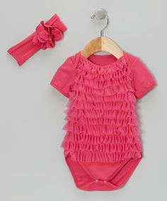 This stylish set has mini mavens covered! Stray tresses are kept in check with a stretchy flower headband. The bodysuit boasts rows of fluffy ruffles all across the front, yet changing remains a cinch with snap-button closures.