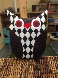 Black, white, and red owl