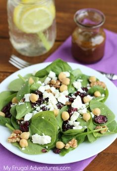 Quick and Easy Spinach Power Salad with balsamic vinaigrette. Make these ahead and pop in a mason jar for a grab n go lunch!