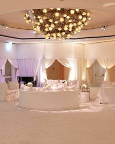 Soft lighting created a romantic atmosphere for guests. Loving the all-white look here!