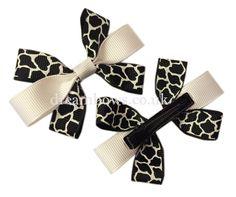 Black and white animal print grosgrain ribbon hair bows on alligator clips - www.dreambows.co.uk