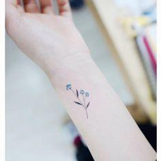 Forget-me-not wrist tattoo