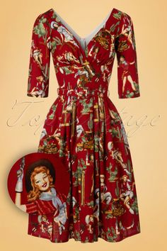 Our heart burns with desire for this 50s Livia Cowgirl Frock Swing Dress... Exclusively available at TopVintage!  All Victory Parade dresses are true art pieces but this vintage inspired beauty has stolen our hearts thanks to the stunning V-neckline with little wrap-over, gathered bust and 3/4 sleeves with tiny slits. The nipped in waist with matching belt and flowy skirt with box pleats create a typical fifties silhouette, oh la la. Made from dark red cotton (doesn't stretch) featur...