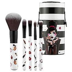 Sephora Collection Izak Brush Set: Create your favorite makeup looks with this chic and cheery set of brushes. The collection is housed in a cylindrical case adorned with the lovely illustrations of French artist Izak Zenou and a striking, black- and-white striped backdrop. Bristles are silky soft and each handle features flirty, feminine images of perfume bottles and dainty, powder puffs. $38