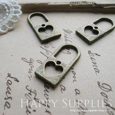 10Pcs Antiqued Vintage Bronze Heart Lock Charms / Pendants (21111). $3,80, via Etsy.