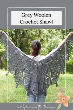 This beautiful dark grey triangle shawl is perfect for any style or occasion! Wear this elegant shawl over an evening gown for a special night out or just to add that bit of extra to a simple outfit. The woolen yarn I used makes this shawl soft and warm! The intricate pineapple motifs add elegance. At the point of each pineapple along the edge of the shawl, I attached a small tassel.