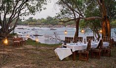 Dine near the river in style with Lufupa Tented Camp Kafue Zambia. Group Camping, Tent Camping, Campsite, Outdoor Furniture Sets, Outdoor Decor, Africa Travel, First Nations, Budget Travel, Wilderness