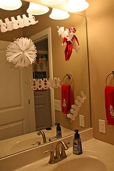 Elf makes paper doll chains