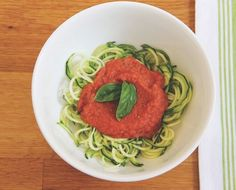 Zucchini pasta with raw/vegan marinara sauce - 2 zucchinis spun on spiral slicer, toss with 1TBS of olive oil if desired. Put 2 tomatoes, 1/4 onion, 1/4 cup basil leaves, 1tsp Himalayan salt, 1 tsp ground pepper, 1/tsp ground ginger, 1/4 squeezed lemon juice into processor. Process till very smooth. Sprinkle nutritional yeast on top if desired. Sound good, no? NaturaSynergy.com