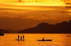 This stunning sunset in Palawan seemed to mesmerize even the local islanders who stood up in their boat and looked with awe as the colors changed with every minute. Palawan, National Geographic Photos, Your Shot, Sunrises, The Locals, Color Change, Amazing Photography, Shots, Boat