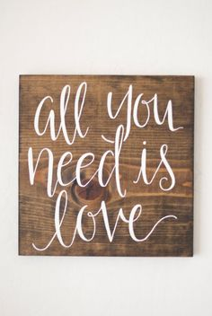 Each sign is cut, sanded, stained, and painted with the Beatles lyrics all you need is love. It makes the perfect gift for newlyweds, or an