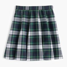 This swingy silhouette is a little bit boy-meets-(school)girl—and a favorite with flats and boots alike. Bonus points for the festive tartan plaid. Sits at waist. Length: 17 1/2. Falls above knee. Poly/wool. Lined. Dry clean. Import. Online only.
