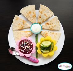 spring flower fun food friday      This fun food friday is in honor of spring. The kids love quesadillas and they're so easy to make. I always buy a rotisserie chicken from the grocery store every week and I have fresh, cooked chicken to use for so many recipes. I often make their sandwiches out of this chicken and it's great for these quesadillas too. It's such a great time saver. I am one busy mom and anything that saves some of my time, is totally worth it. Here's how I made this week's…